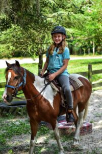 One of our Pony Pals group members riding Blaze.